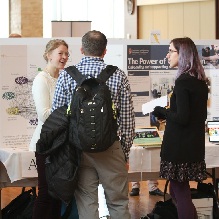 Poster presenter shares information with visitors